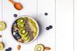 Leinwanddruck Bild - Green smoothie bowl with kiwi, blueberry and chia seeds