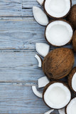 Coconuts on a rustic wooden background. - 216951541