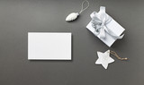 A Gift Box and Christmas Decorations on gray background. Symbolic image. Flatlay. Copy space - 216955191