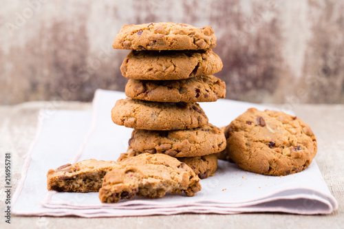 Chocolate oatmeal cookies on the wooden background.