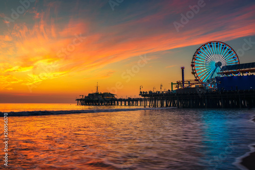 Visitors enjoy sunset above Santa Monica Pier in Los Angeles