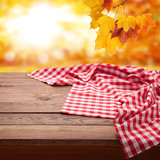 Red checkered tablecloth on wooden table with autumn background. Napkin close up top view mock up. Kitchen rustic background. - 216959123
