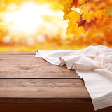 Empty wooden table with tablecloth. Napkin close up top view mock up. Autumn rustic background. - 216959184