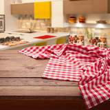 Red checkered tablecloth on wooden table. Napkin close up top view mock up. Kitchen rustic background. - 216959306