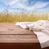 Empty wooden table with tablecloth. Napkin close up top view mock up. Autumn rustic background. - 216959360
