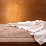 Empty wooden table with tablecloth. Napkin close up top view mock up. Kitchen rustic background. - 216959374