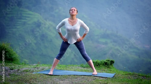 Obraz na płótnie Woman doing Ashtanga Vinyasa Yoga asana Prasarita padottanasana