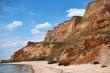 Quadro beautiful sea summer landscape, wild beach closeup, sea coast with high hills and cloudy sky