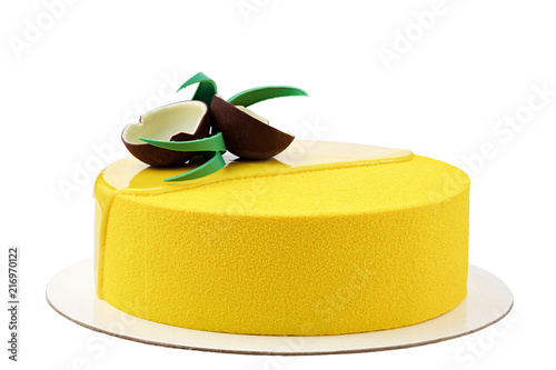 Foto Murales Yellow tropical mousse cake isolated on white