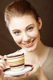 portrait of a beautiful young woman with a cup of coffee