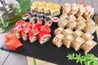 Sushi rolls set served on slate on dark background