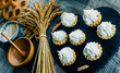 Close up tartlets with cream and spikelets on black stone stand