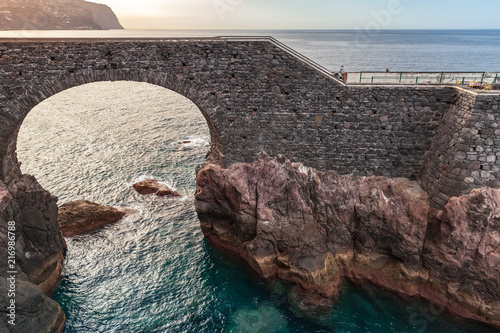 Leinwandbild Motiv Old stone bridge in Ponta do Sol, Madeira