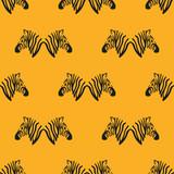 Seamless orange pattern with zebra heads. - 216989762