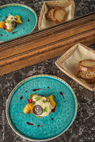 Foto Murales exclusive cheese mousse with marinated walnuts and golden beetroot served on turquoise plate, top gastronomy