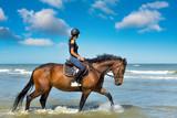cavalière sur la plage ensoleillée  - 216991794