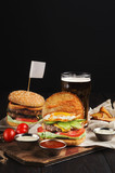 Set of junk food diner with hamburger and potato served with beer - 216997371