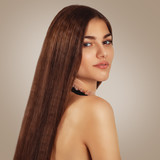 Portrait of a beautiful young woman with luxurious long hair