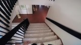 Walking down the stairs in a big house, filmed in a point-of-view. - 217003734