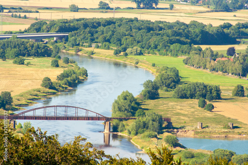 Fototapeta Bridge on the Weser river in Germany. A beautiful view from the monument of Prince Wilhelm in Porta Westfalica.