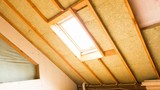 house attic under construction mansard wall insulation with rock wool - 217019572