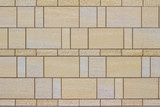 Modern stone tile wall background with a marble looking beige stones arranged in a stained glass style
