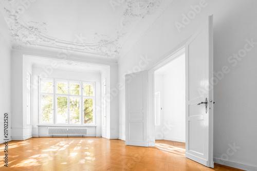 Leinwandbild Motiv empty apartment room, flat with wooden floor and stucco ceiling