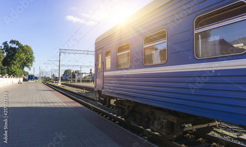Power lines on the railway. Blue sky, sunlight. Railway