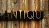 ANTIQUE brass write on wooden background - 3D rendering - 217029188