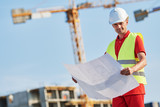construction worker with blueprint at building area - 217032110