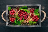 Fresh Raspberry Berries. On a wooden background. Top view. Free space for your text.