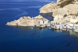 Fishing village Firopotamos on the island of Milos, Cyclades, Greece. Nice Copy space in the sea at the bottom. - 217041541