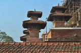 Buddhist pagodas on the background of a tiled roof