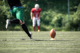 American football player kicking ball - 217049126