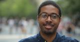Black man in city smile face portrait - 217051166