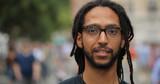 Black man in city smile face portrait - 217051180