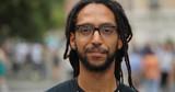 Black man in city smile face portrait - 217051191