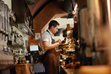 Barista Preparing Coffee In Coffee Shop - 217056774