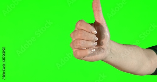 Female hand gestures on green screen: thumbs up - 217062925
