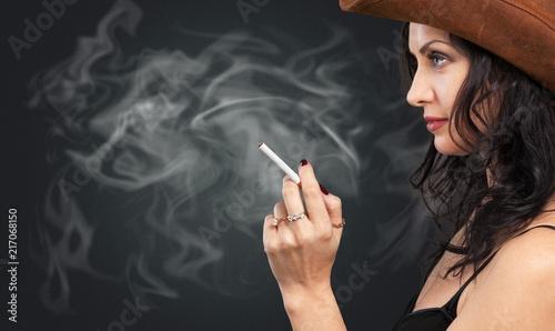 Leinwanddruck Bild Beautiful elegant girl smoking