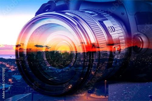 Leinwandbild Motiv Professional camera on city background