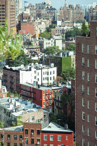 Fridge magnet view on Manhattan streets and roofs