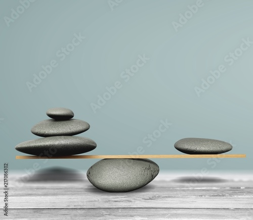 Plexiglas Zen Zen basalt stones on desk