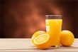 Leinwanddruck Bild - Orange juice and slices of orange on