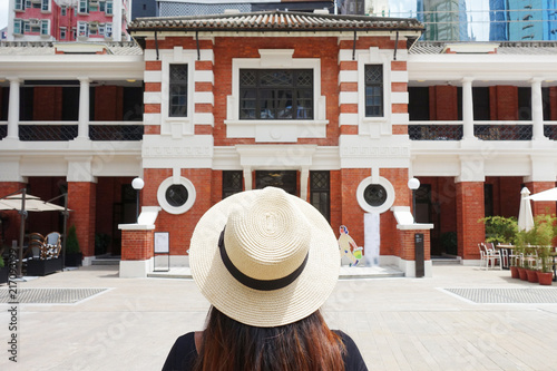 Foto Murales Tourist is visiting Tai Kwun Centre for Heritage and Art museum new travel place in Central district in Hong Kong.