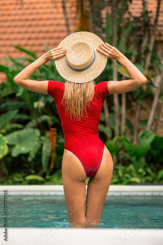 Fashion Portrait Of A Beautiful Young Woman In Sexy Red