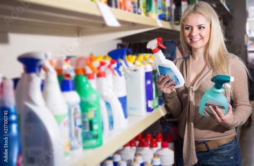 female customer buying detergents