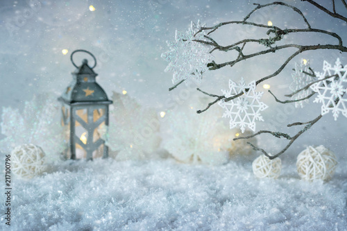 Foto Murales Frosty winter wonderland with snowfall and magic lights.  Christmas greetings concept