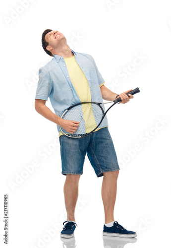 Aluminium Tennis sport, leisure and people concept - happy young man playing tennis racket as imaginary guitar over white background