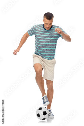 Fotobehang Voetbal sport, leisure and people concept - young man freestyle juggling soccer ball over white background